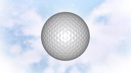 golfové hřiště : Digitally generated white rotating golf ball with background of the sky with clouds Dostupné videozáznamy