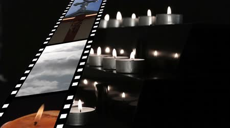 evangelical : Digitally generated film strip showing different videos and pictures about religion while candles are lit and blown at the end