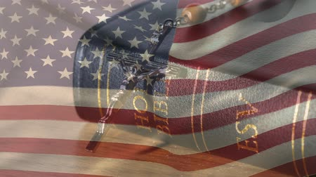 el yazması : Digital composite of the american flag waiving while background shows a bible and crucifix Stok Video