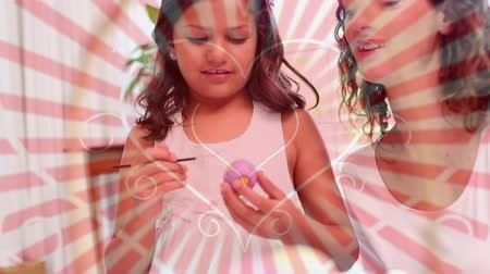 vasárnap : Digital composite of mother and daughter painting easter eggs. Hearts on background