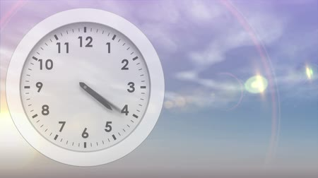 밤 : Digitally generated moving white clock with background of the sky turning to night 무비클립