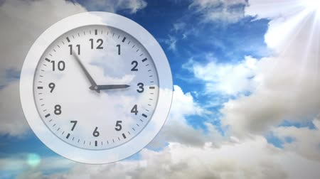 minute : Digital composite of front view of white clock with hands moving quickly on a background of sky with clouds Stock Footage