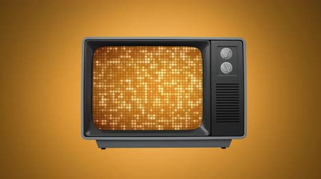 presleme : Front view of an old television showing a video of retro gold pattern