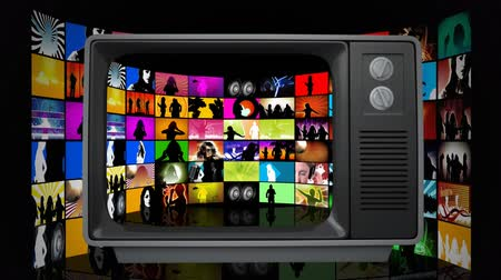 changing channel : Front view of an old television showing collage of retro videos. Background shows square patterns with retro videos. Stock Footage