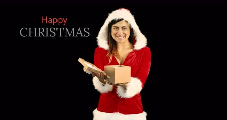 senhora : Woman in red Christmas themed hoodie opening her present with a Christmas greeting text beside her 4k