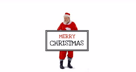 záradék : Full view of dancing Santa Claus in a white background with a Christmas greeting card in the foreground 4k Stock mozgókép