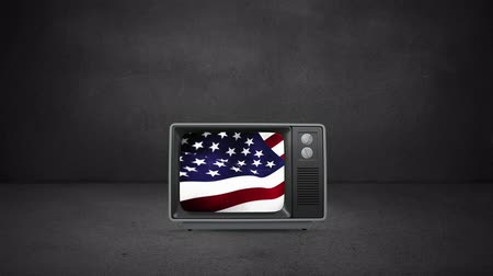 old glory : Digital animation of a television turning on to reveal a waving US flag Stock Footage