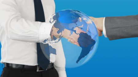 hanedan arması : Close up of handshake between two businessmen with a digital animation of globe in the foreground Stok Video