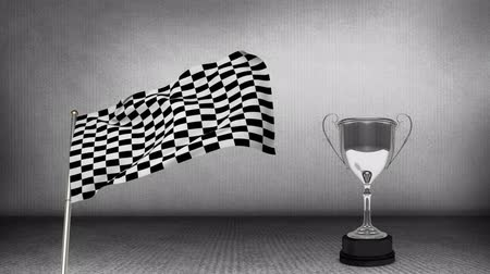 pista de corrida : Digital animation of a racing flag hanging on a pole beside a trophy cup