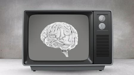 temporal : Digital animation of a television in a grey room turning on to revealing a rotating human brain.