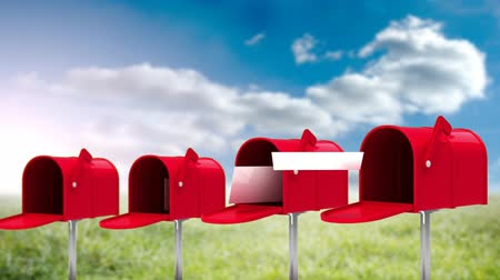 schránky : Digital animation of four red mailboxes with paper flying out on a sky background