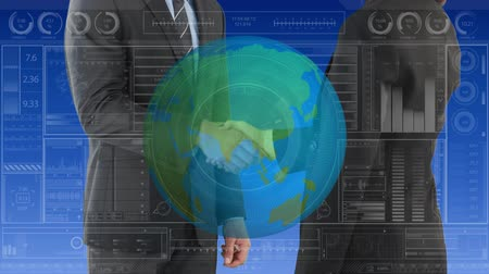 reaching : Digital animation of a handshake between businessmen with semi transparent globe and statistics in the foreground