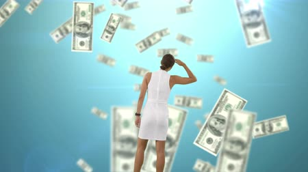 us banknotes : Rear view of a businesswoman gazing at a digital animation of the sky with dollar bills falling Stock Footage