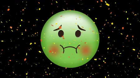 vomit : Digital animation of a green nauseated face emoji with digital confetti on a black background Stock Footage