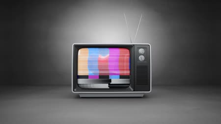 стандарт : Front view of a television that starts with a no channel screen and then projects a heart with a blue background. The TV is in an empty grey room