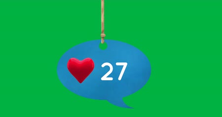 縛ら : Digital animation of a heart icon and numbers increasing inside a tied up blue speech balloon on a green background 4k 動画素材