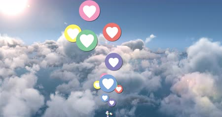 interaktif : Animation of heart icons flying upwards with a sky background 4k