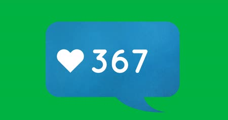 interaktif : Animation of counting numbers in a blue chat box with a heart icon on a green background 4k Stok Video