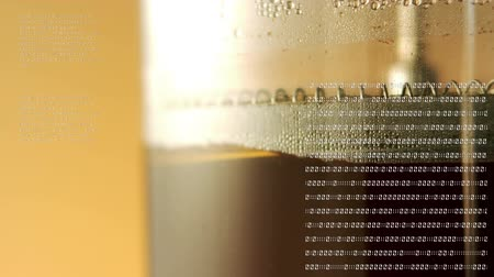 kód : Close up of a wine press with brown background. Binary codes are running on the glass