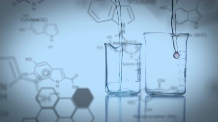 pipette : Close up of two beakers being filled with water and a background filled with chemical equations Stock Footage