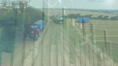 ortalama : High angle of industrial trucks moving in an agricultural field with moving average charts in the foreground