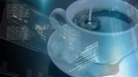 kávézó : Close up of a coffee mixing with milk with a background of screens and interface codes