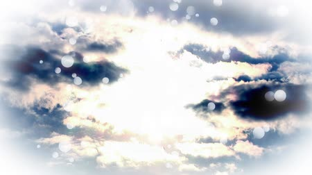 heavenly : Digital animation of a hand touching a bright cloudy sky