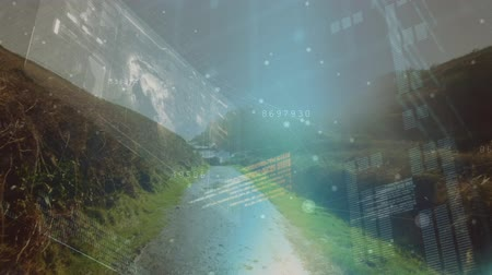 beside : Drone shot of a trail beside a stream with interface codes on screens running in the foreground Stock Footage