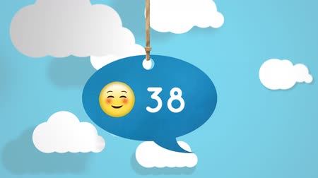 digitální : Animation of an blue chat bubble hanging from a thread with a happy face emoticon and numbers count increasing. The background an animation of the sky with clouds