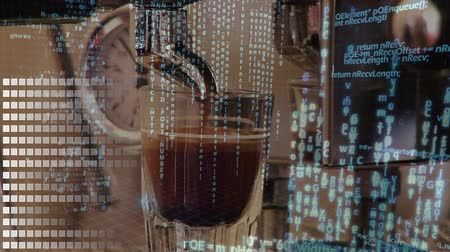 dispensing : Close up of a coffee maker dispensing coffee while program codes are running in the background