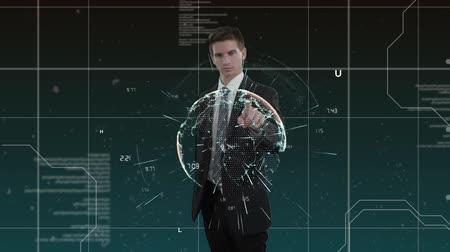 tenso : Digital animation of a Caucasian man in suit with codes and digital background. He activated and manipulated an earth hologram, which emitted particles away