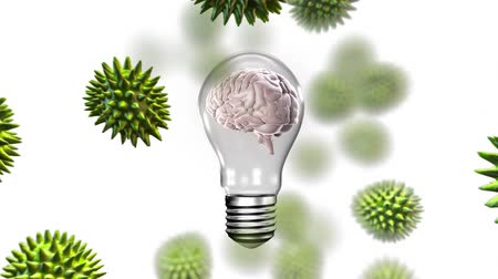lobe : Lateral view of a rotating human brain inside a transparent light bulb attacked with green animated viruses in 3d. Stock Footage