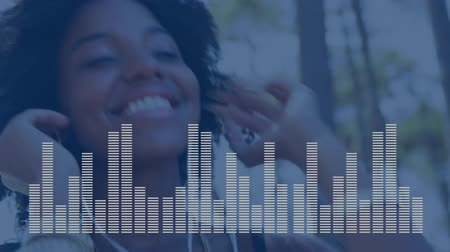 wizualizacja : Close-up view of a young Black American woman happily listening to her favorite upbeat music. Random white digital bars moving on foreground