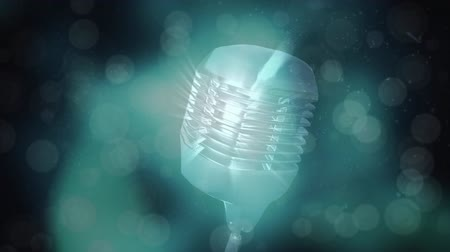 wizualizacja : Digital animation of a rotating shiny vintage microphone. Random light and circle animation on the background