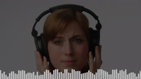 wizualizacja : Close-up view of a young Caucasian woman happily listening to her favorite upbeat music with a headphone. Random white digital bars moving at the bottom