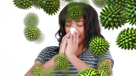 allergen : Close-up view of a sneezing young Caucasian woman with random green pollen grains moving toward her
