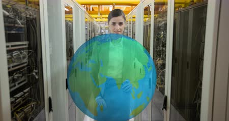 tenso : Digital animation of a young Caucasian female technician in front of a rotating Earth hologram in an aisle view of a server room 4k