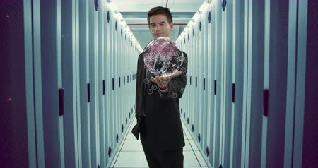 tenso : Digital animation of a young Caucasian male technician in business suit raising his hand and showing an Earth hologram, in an aisle view of a server room 4k