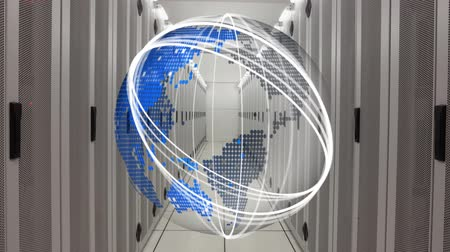 harde schijf : Digital animation of the world globe in grid with moving spherical rings at the center aisle of data server room. Stockvideo