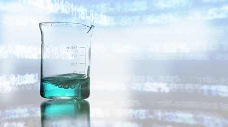aqueous : Digital animation of a glass beaker with blue liquid swirling in it and data scrolling on the background