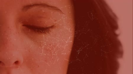 filtre : Digital animation of light connections moving on a red background showing a women opening her eye