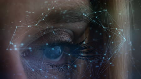 összekapcsol : Digital animation of a women blue eye open surrounded by light connections Stock mozgókép