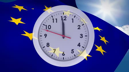 meio dia : Digital animation of a clock against an European flag turning into a British flag on a sunny sky background Vídeos