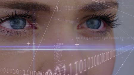 estatísticas : Digital animation of a women blinking her eye with digital data connected on the foreground