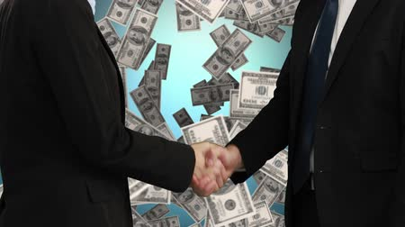 sofisticado : Digital composite of businessman and businesswoman shaking hands while dollars fall down in the background Stock Footage