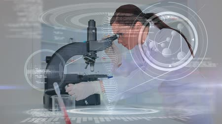 forensic science : Digital composite of pretty Caucasian female scientist looking through microscope while binary codes move on the foreground Stock Footage