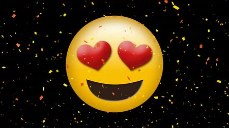 обмен сообщениями : Digital animation of a face with heart eyes emoji on a black background with digital comfetti