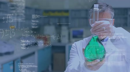 тестирование : Digital composite of a male Caucasian scientist studying a chemical and a foreground filled with graphs and equations