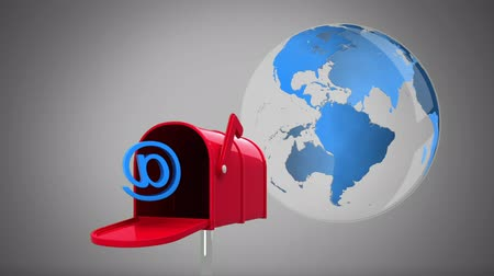 beside : Digital animation of a mail box containing an at sign beside a rotating globe