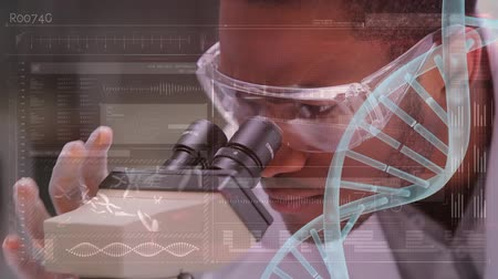 pipette : Digital composite of an African-american male scientist and a Caucasian female scientist taking tuns looking at a microscope and a foreground with DNA helix and statistics